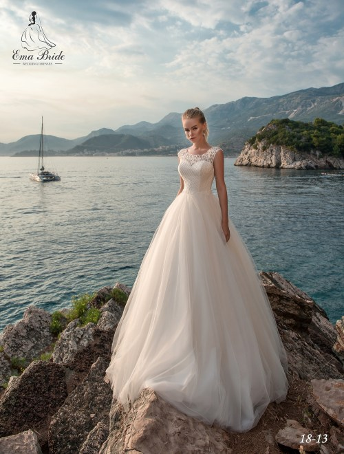 Lush, classic wedding dresses by Emabride with train